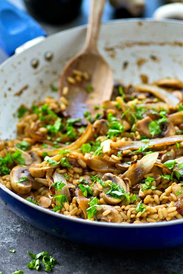 Flavorful caramelized onions, mushrooms, and balsamic are the star flavors in this SUPER-creamy risotto that comes together easily in one pan in less than 30 minutes!