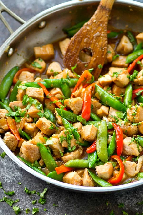 This easy one-pan chicken stir-fry skillet is packed with tons of pretty spring veggies and fresh ginger with a homemade Asian sauce makes it so flavorful!