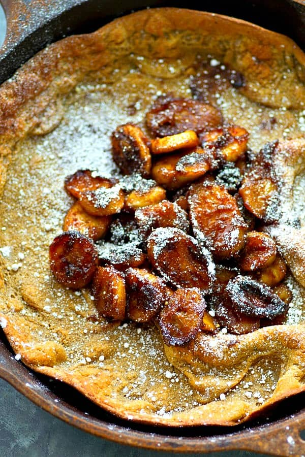 The ultimate lazy weekend breakfast! This bananas foster-style dutch baby is filled with tons of caramelized bananas and you won't believe how easy it is to throw together!
