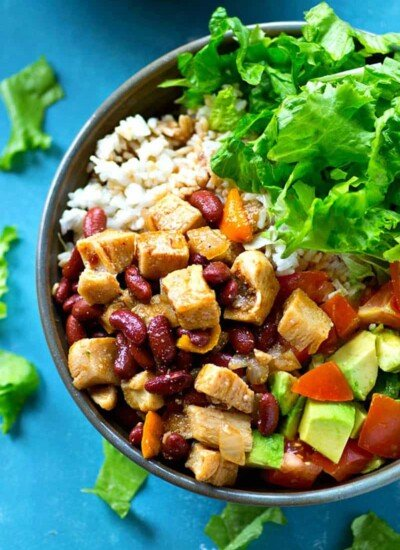 Loaded with spicy chicken and beans, tons of hot rice, and all the salad bowl 'fixins, these flavorful weeknight salad bowls are the EASIEST way to get everyone to eat their salad!