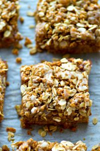 These loaded cookie bars are a peanut butter and jelly lover's dream! An oatmeal streusel topping and tons of glaze drizzled on top make them so fun and kid-friendly.