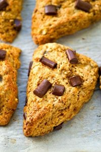 These lightened-up banana chocolate chunk scones are unbelievably flaky and moist thanks to greek yogurt and they're so amazing with your morning coffee!