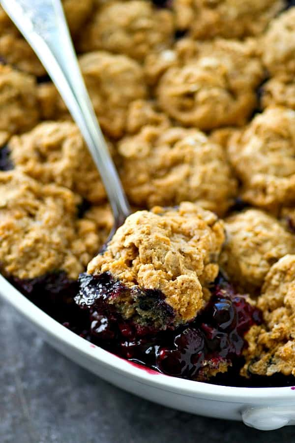 The BEST mixed berry cobbler you'll ever have! Fluffy oat biscuits paired with a double-whammy of juicy berries make for one killer cobbler.---Eat it warm with lots of whipped cream!
