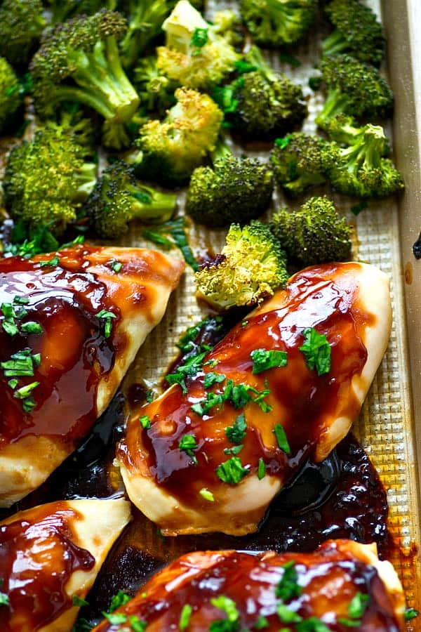 Homemade teriyaki chicken made UNBELIEVABLY easy! Everything bakes up in one sheet pan and you won't believe how flavorful the homemade sauce and roasted broccoli is!