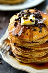 Almond butter makes these chocolate chip pancakes SO extra fluffy, you won't be able to resist devouring an entire stack! The batter mixes up in only minutes for a quick weekday breakfast.