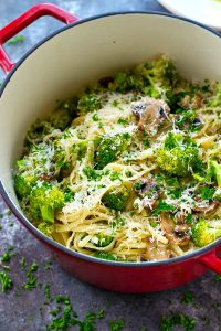 Browned butter makes this killer weeknight Parmesan fettuccine SO unbelievably flavorful! Roasted mushrooms and broccoli make it an entire vegetarian meal-in-one!
