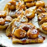 Melt-in-your-mouth coconut crepes and a sweet caramelized banana sauce are a match made in heaven in these killer crepes! They're gonna steal the show at any brunch!