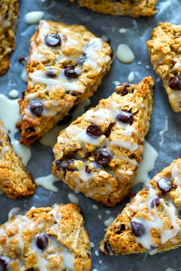 Drizzled with tons of vanilla glaze and unbelievably flaky, these oatmeal chocolate chip scones are a killer breakfast indulgence with your morning coffee!