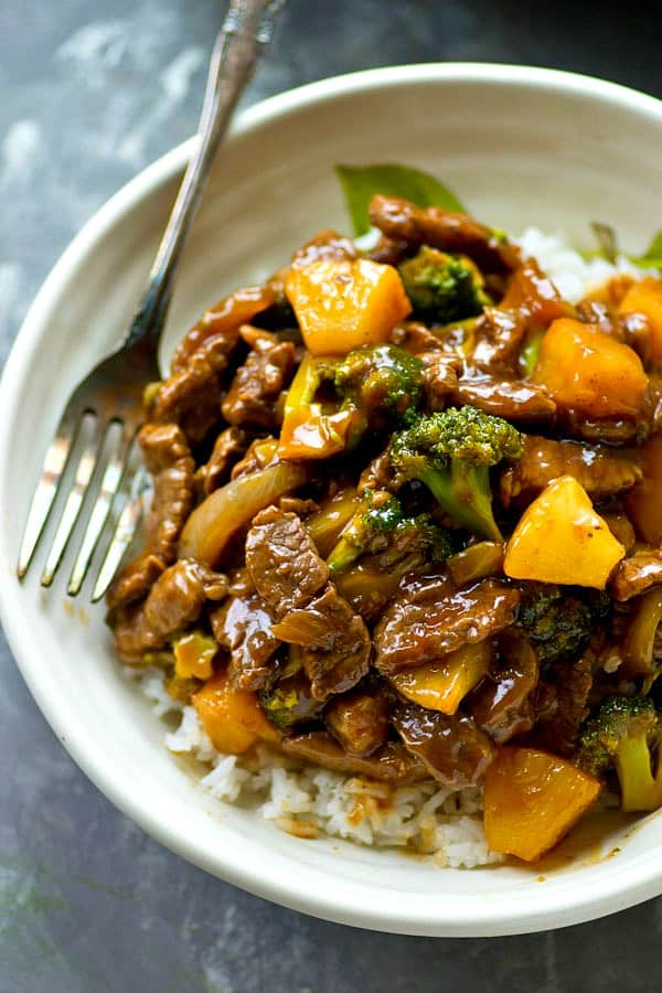 Classic beef and broccoli stir-fry gets a tropical makeover with sweet pineapple and the most AMAZING sauce ever! Ready to go in 20 minutes and you probably have all the ingredients!