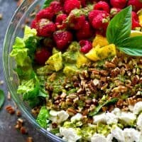 Soft goat cheese and sweet raspberries are a match made in heaven in this raspberry pecan goat cheese salad that's tossed in tons flavorful fresh basil vinaigrette.