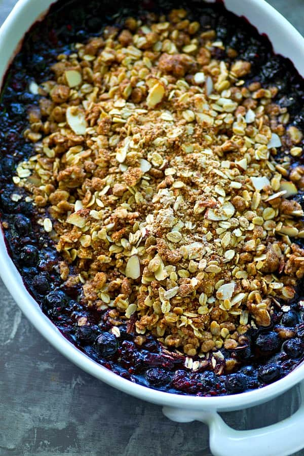 Packed with a mix of summer berries and piled high with buttery streusel, this mixed berry streusel crumble is a quintessential easy dessert for summer!