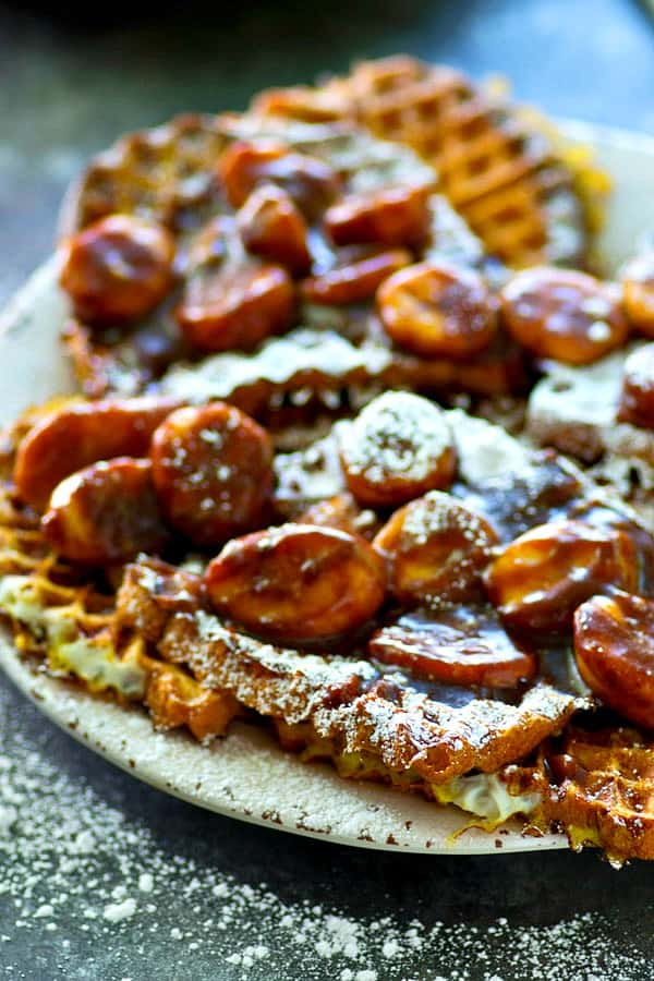 French toast made waffle-style and covered with the most AMAZING mocha caramelized banana sauce ever! You'd never guess it's ready in only 20 minutes!