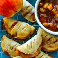 These mini-sized peach hand pies are packed full of juicy fresh peach filling and you won't BELIEVE how easy they are to throw together at a moment's notice!---Kids will demolish these hand pies!