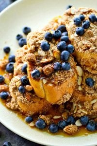 Baked entirely on one sheet pan in less than 20 minutes and covered with tons of buttery streusel, this baked almond streusel french toast is going to be your new weekend brunch favorite!