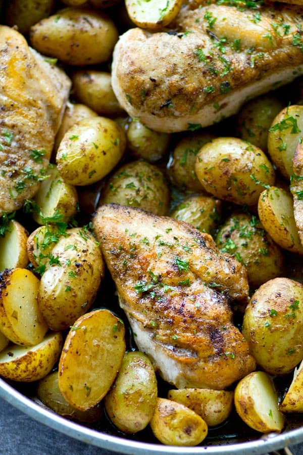 TheEASIEST and most mess-free way to do weeknight chicken and potatoes! This skillet roasted chicken bakes in a flavorful lemon herb sauce and is quickly gonna become a weeknight staple!