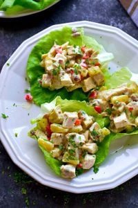 The EASIEST lettuce wraps you will ever make! These tropical-style pineapple pecan chicken salad lettuce wraps are a lunchtime game-changer.