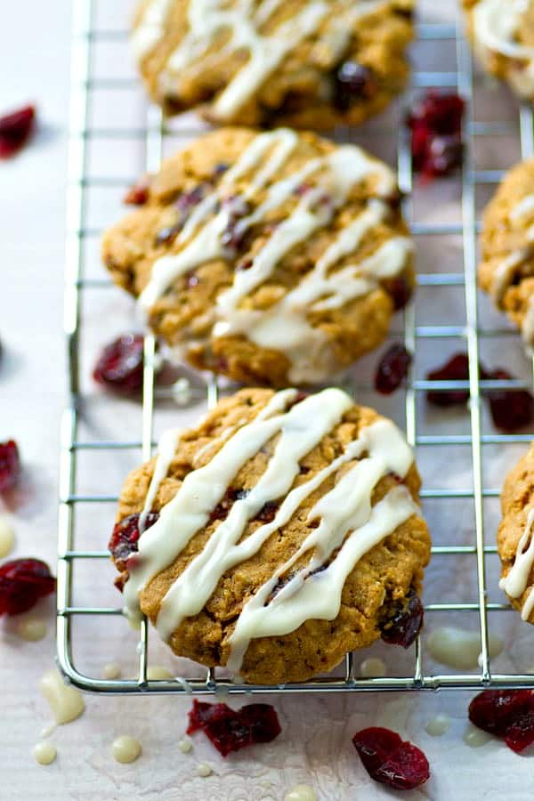 You've never had oatmeal cranberry cookies this loaded before! Tons of chai spice, soft cranberries, and sweet vanilla glaze make these oatmeal cookies a crowd-pleaser every time!