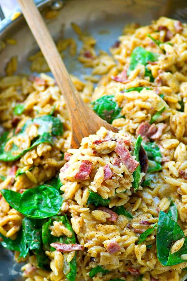 This cheesy spinach bacon orzo is everyone's favorite weeknight comfort food and nobody will ever guess it's made in ONE pot in less than 30 minutes!