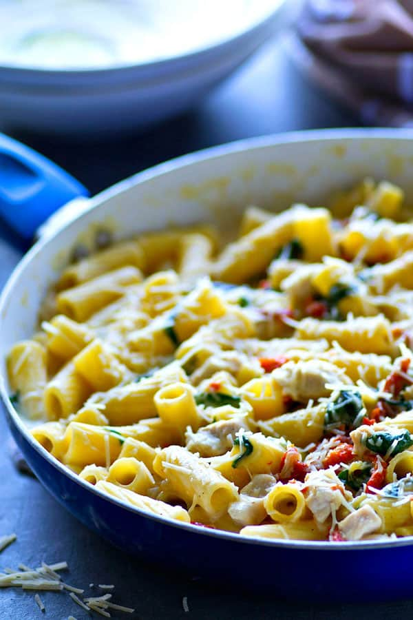 This flavor-packed chicken pasta alfredo is loaded with tender chicken, spinach, and sun-dried tomatoes for the ultimate one-pot weeknight pasta dinner!