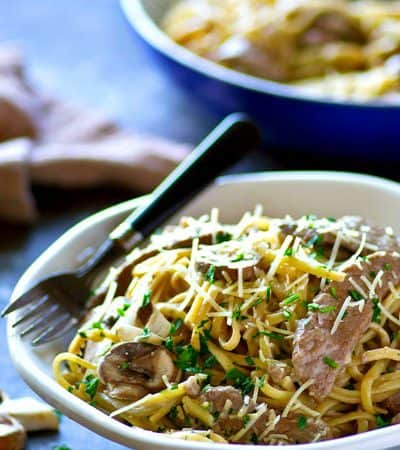 Creamy mushroom balsamic alfredo sauce and juicy beef transform this fettuccine alfredo into a massively flavorful dinner that will quickly become a regular on your dinner rotation!