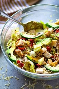 This beautiful quinoa salad is packed full of juicy chicken, soft sun-dried tomatoes, tons of avocado, and a flavorful balsamic dressing for the healthiest + prettiest salad you could ever dream of!