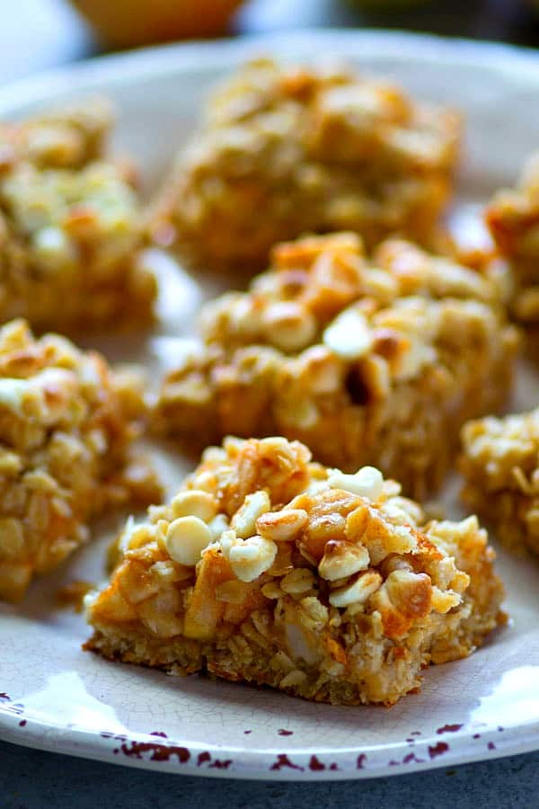 White chocolate, oatmeal, and apples are a trio made in heaven in these streusel-covered cookie bars! So easy to make and you won't be able to stop eating them!