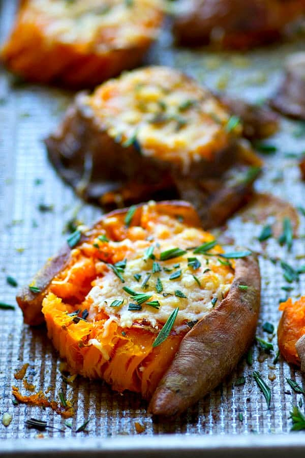 You won't BELIEVE how much flavor is packed into these easy smashed sweet potatoes! They're so crispy and covered in rich browned butter and tons of flavorful Parmesan cheese.