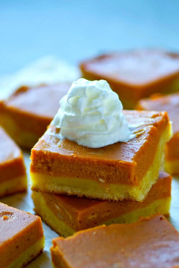 A soft sugar cookie crust and silky bourbon-spiked pumpkin filling makes these stunner pumpkin pie bars the ultimate holiday treat for your dessert table!