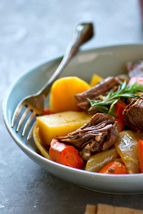 The secret behind what makes this beef pot roast so incredibly tender is low 'n' slow braising it in half apple cider and half beef broth.---coziest hands-off dinner EVER!