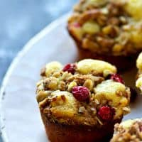 Packed with tangy cranberries and piled high with walnut streusel, these ultra-soft cranberry lemon walnut crumb muffins are the only holiday muffin you need on your brunch table!