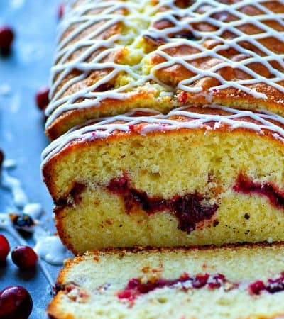 This glazed almond pound cake may look simple on the outside, but inside hides a beautiful cranberry swirl.---It's a stunner for any holiday dessert table.