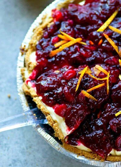Completely no-bake and thrown together in MINUTES this pretty cranberry orange cheesecake pie is the easiest festive dessert to whip up this holiday season!