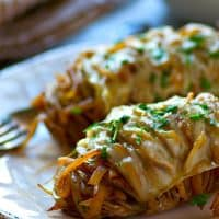 Hasselback baked potatoes are filled with tons of caramelized onions and topped off with Swiss cheese for one knock-out easy dinner side!
