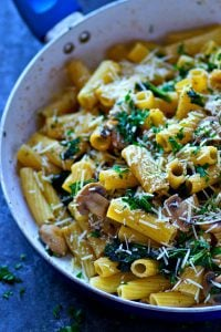 Flavorful browned butter and tons of caramelized mushrooms and kale transform rigatoni pasta into a no-fuss and MASSIVELY flavor-packed dinner side!
