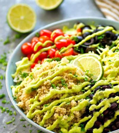 Packed with tons of Mexican-style goodness and drizzled with a creamy avocado lime dressing, this colorful quinoa salad is so easy and so dang good, it will quickly become a dinner regular!
