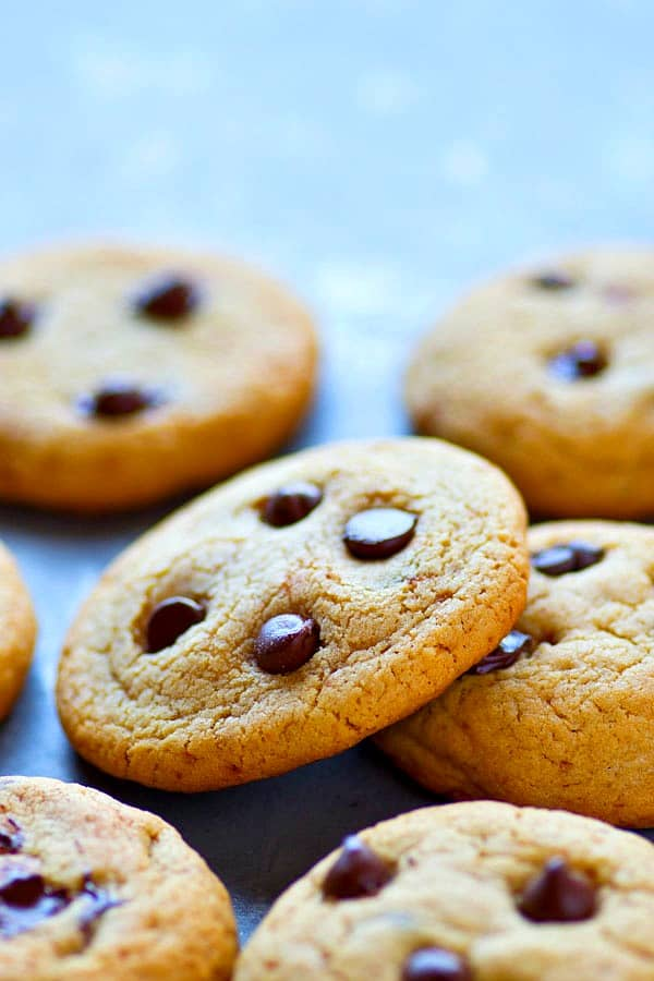 Thin and crispy chocolate chip cookies JUST like you get at the bakery! These cookies are made in only minutes in one bowl and NO chilling required.---your new cookie jar favorite!