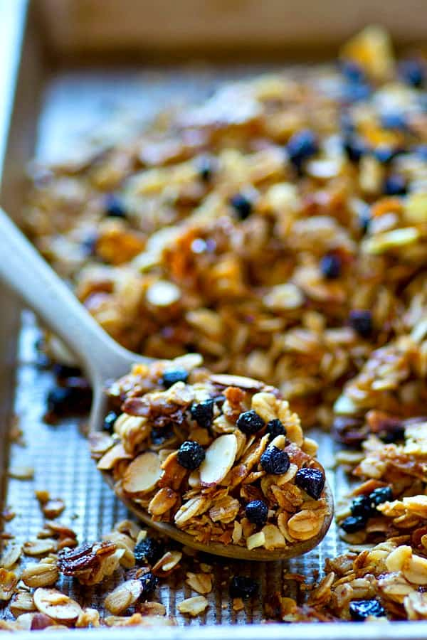 Huge clusters and tons of dried blueberries star in this INSANELY addicting blueberry muffin almond granola.---It's amazing with greek yogurt or just by the handful!