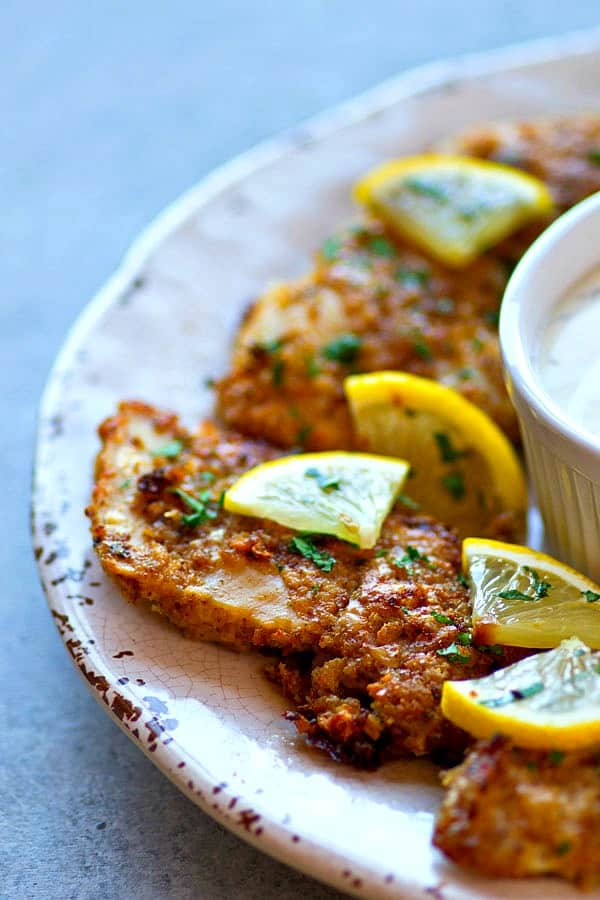 Ultra-crispy on the outside and incredibly juicy on the inside, these oven-fried lemon Parmesan chicken tenders are so good and so easy, they're going to instantly become a dinner staple!