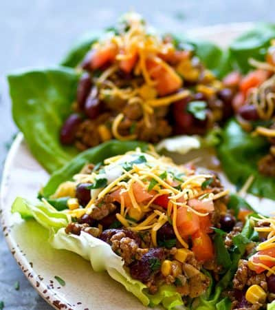 All the things you love about taco salad are piled into these INSANELY flavor-packed taco salad lettuce wraps! They're ready to go in 20 minutes with only a handful of simple ingredients.