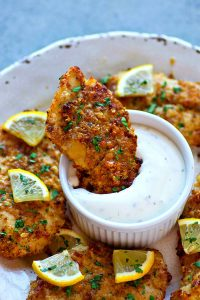 Ultra-crispy on the outside and incredibly juicy on the inside, these lemon Parmesan oven-fried chicken tenders are so good and so easy, they're going to instantly become a dinner staple!