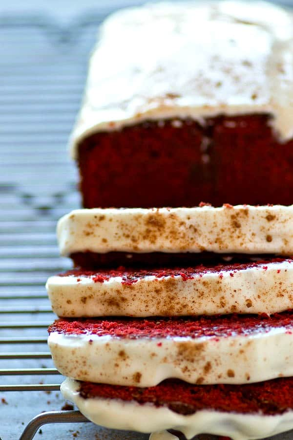 Soft, buttery red velvet pound cake covered in a tangy cream cheese glaze is a breeze to throw together and it's an insanely impressive dessert for any of your loved ones!