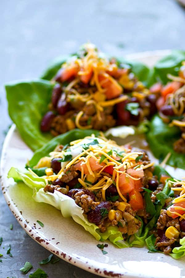 Spicy Beef Taco Lettuce Wraps--All the things you love about taco salad are piled into these INSANELY flavor-packed taco salad lettuce wraps! They're ready to go in 20 minutes with only a handful of simple ingredients.