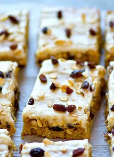 Soft, chewy and packed with tons of oats and raisins, these frosted oatmeal raisin breakfast bars are the ULTIMATE grab 'n' go breakfast! You won't believe they're on the lighter side.