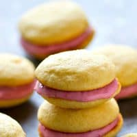 Soft, cake-like vanilla cookies and a tangy raspberry cream cheese filling are the perfect match in these insanely gorgeous whoopie pies! There's no stopping at only one.