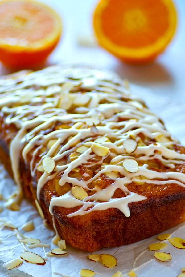 Orange and almonds are a match made in heaven in this INSANELY-moist glazed almond orange quick bread! It's quick to throw together and disappears even faster.