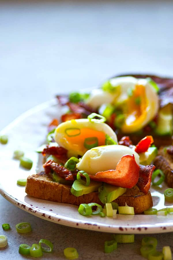Piled high with beautiful soft-boiled eggs and lots of crispy bacon, this bacon avocado toast is an absolute BREEZE to throw together and the ultimate stunner breakfast!