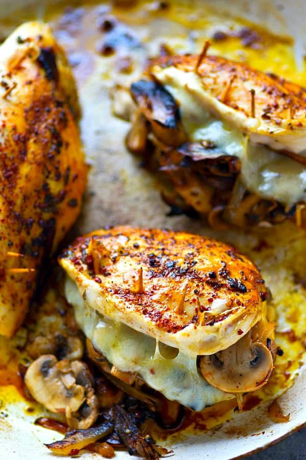 Stuffed with flavorful caramelized onions, mushrooms and gooey swiss cheese, these stuffed chicken breasts are WAY easier than they look and the perfect way to up your chicken game!