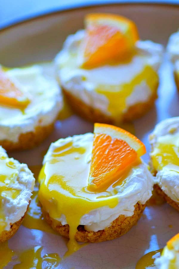 These creamy orange curd mini cheesecakes are completely no-bake and can be prepped within minutes! A tangy homemade orange curd on top makes them irresistible.