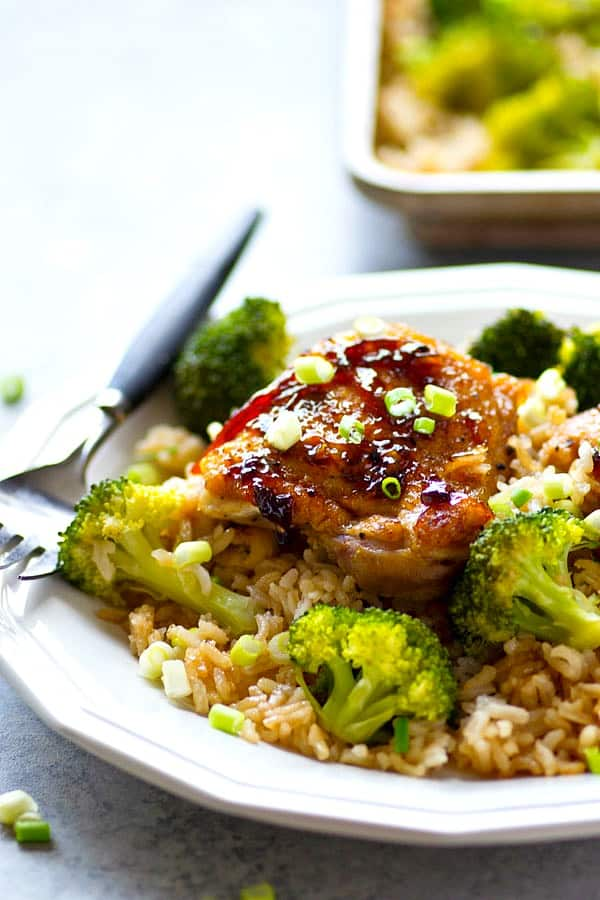 Insanely easy to prep and ready in only 40 minutes, this sheet pan orange chicken with rice and broccoli is packed with tons of citrus-y orange goodness and the ultimate hands-off dinner!