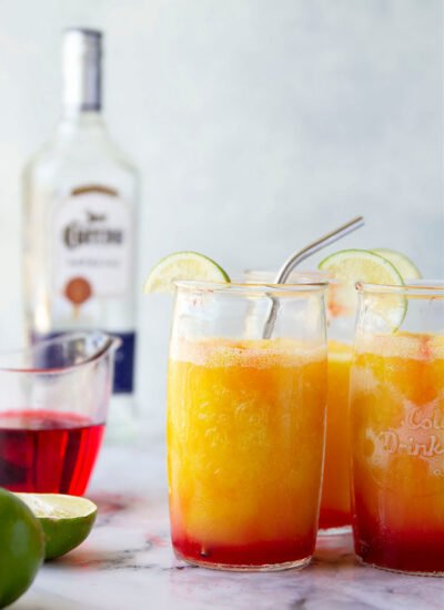 These tequila sunrise slushies are a frozen twist off of the classic cocktail and they're SO easy to blend up!